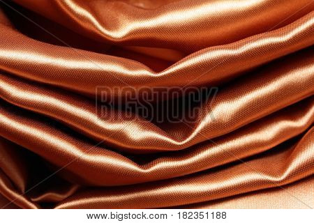 gold crumpled silk fabric textured background