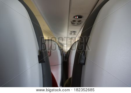 looking between rows of airplane seats while traveling.