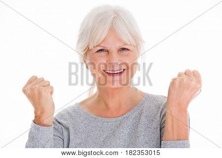 Senior woman clenching fists