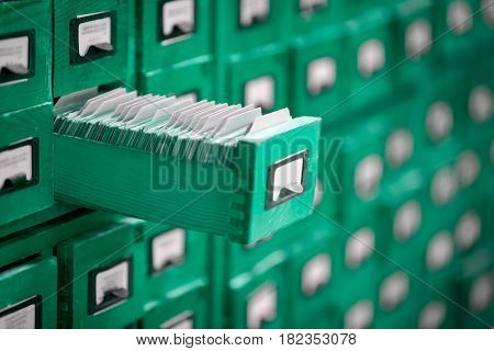 library or archive reference catalogue with opened card drawer.