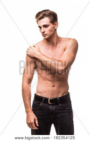 Young Man Suffering From Pain In His Shoulder On White