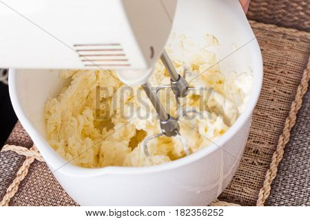 Mixing cake dough with butter. Macro. Photo can be used as a whole background.