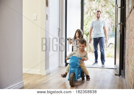 Excited Children Arriving Home With Father