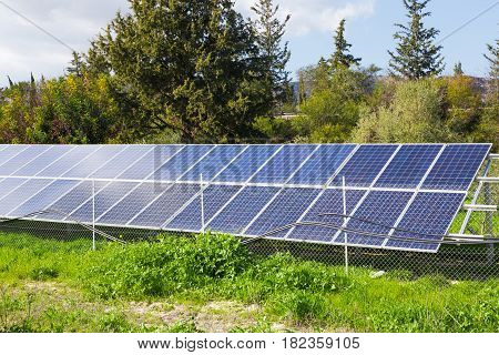Solar panels placed on a countryside meadow