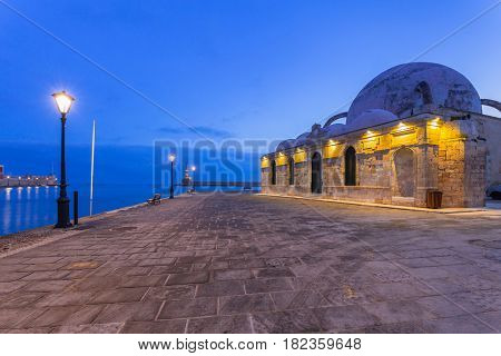 Old mosque in Chania port at night on Crete, Greece