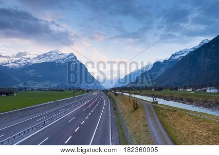 Alpine landscape. The road and the river flows side by side. In the direction of Gotthard.