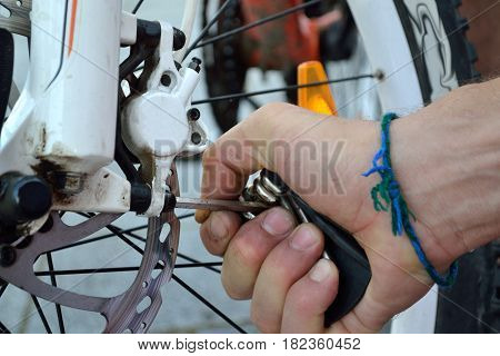 Person puts brake of a bicycle - close-up