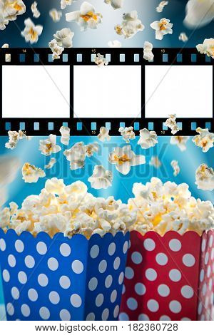 Boxes of popcorn on blue background, close-up.