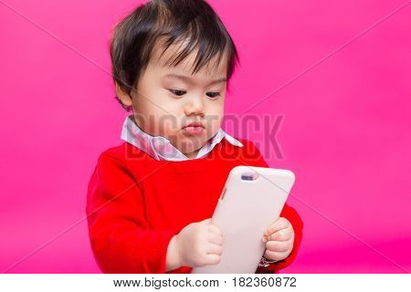Kid boy play with mobile phone