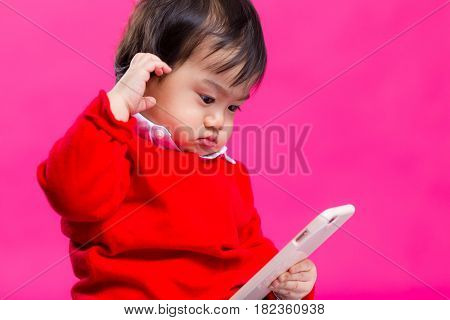 Asian boy play with mobile phone