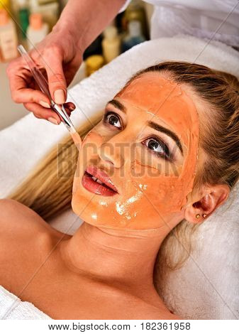 Collagen face mask . Facial skin treatment. Face of woman receiving cosmetic procedure in beauty salon close up number one isolated.
