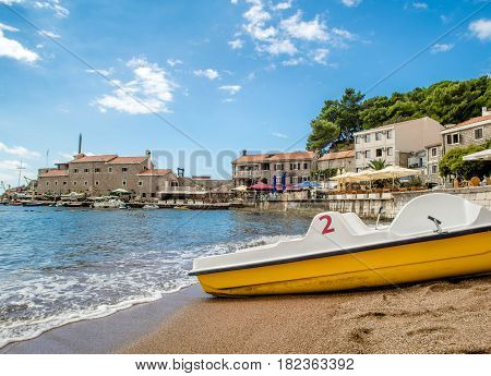 PETROVAC, MONTENEGRO - SEPTEMBER 20, 2016:The old town of Petrovac with an ancient fortress and a bay for tourist and fishing vessels, Montenegro.
