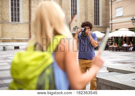 Shot of a young tourist couple taking photos while sightseeing.
