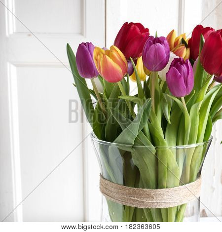 Close up of a bouquet of colorful tulips in vintage style for mothers day