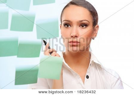 Pretty business lady or student looking at a whiteboard