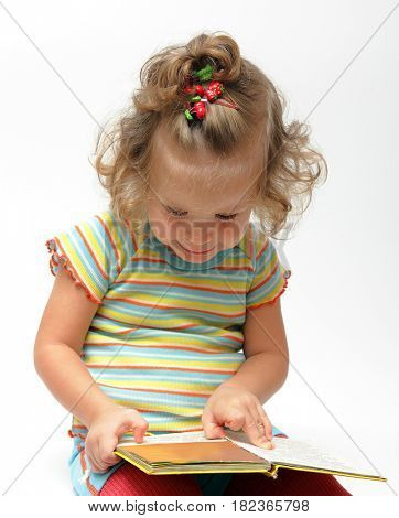 cute little girl sitting with book