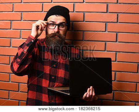 Bearded Brutal Caucasian Hipster Holding Laptop