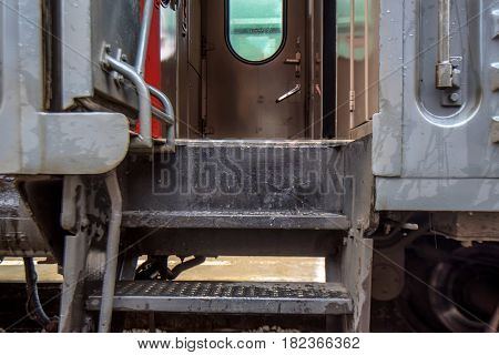 Close-up image of passenger railroad car at station with door open