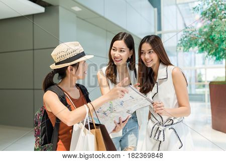 Woman travel in bangkok and asking for destination with local people