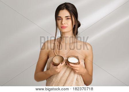 Beautiful woman in soft towel hoding box of salt scrub. Beauty treatmen. Skin care.