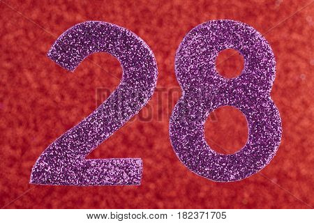 Number twenty-eight purple color over a red background. Anniversary. Horizontal