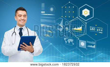medicine, people and healthcare concept - smiling male doctor with clipboard and stethoscope over blue background and virtual charts