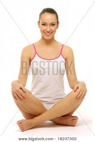 Foto von hübsche Frau auf dem Boden sitzend