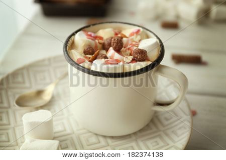 Composition with tasty cocoa and marshmallow on table, closeup