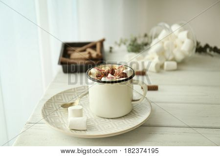 Composition with tasty cocoa and marshmallow on wooden table