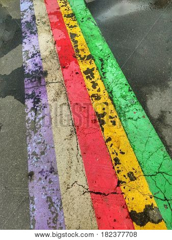 Abstract colorful stripes on the asphalt