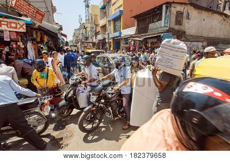 BANGALORE, INDIA - FEB 12, 2017: Mess on crossroad with crowd of busy people motorbikes making traffic jam on February 12, 2017. Capital of the state Karnataka has a population of 8.42 million