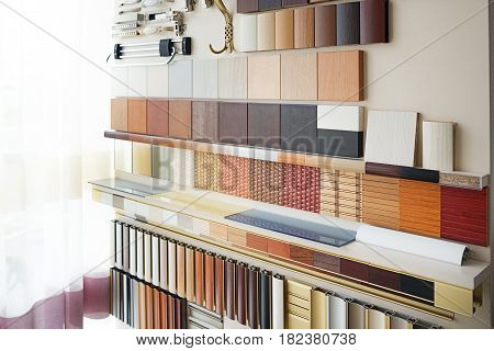 Furniture fittings multicolored chipboard panels close-up background laminated chipboards color palette texture furniture sample parquet boards in hardware store in home improvement warehouse exterior