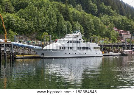 A massive white yacht docked in Juneau Alaska