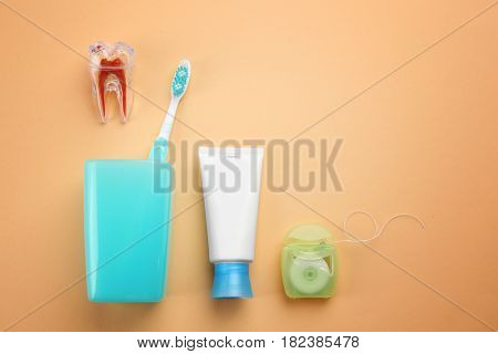 Set for teeth cleaning on color background