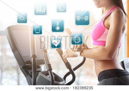 Sport application concept. Young woman with fitness tracker in gym
