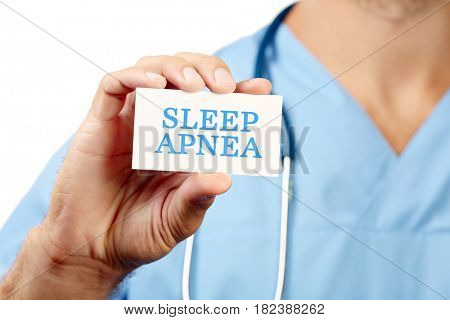 Doctor holding card with text SLEEP APNEA, closeup