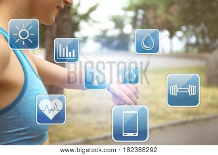 Sport application concept. Young woman with fitness tracker outdoor