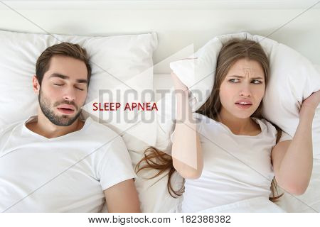 Young woman suffering from husband's snore. Obstructive sleep apnea concept