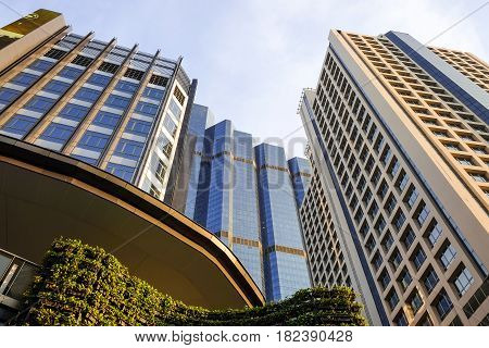 Bottom view of modern skyscrapers in business district against blue sky Bangkok Thailand