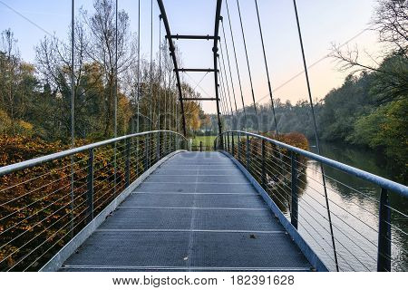 Pedestrian and bicycle track along the Lambro river Monza Brianza Lombardy Italy) at fall. Bridge