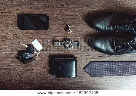 Accessories groom's wedding day. Wallet watch cufflinks tie shoes mobile phone car keys.