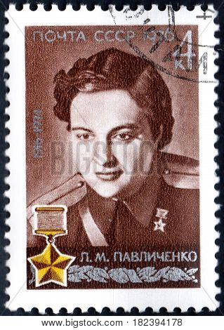 UKRAINE - CIRCA 2017: A postage stamp printed in USSR shows Portrait of Hero of USSR Pavlichenko with inscription 60th Birth Anniversary of L.M.Pavlichenko circa 1976