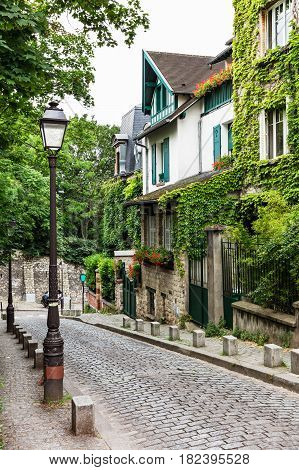 The charming old street of Montmartre hill in the summer day are full of art galleries cafes and shops to walk about.