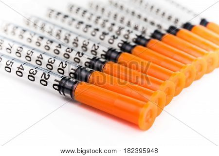 100 Units Insulin Syringes On White Background
