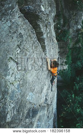 male rock climber on the cliff. man climber climbs on a rocky wall.