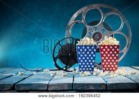Old style movie reels with pop corn, still-life, close-up.