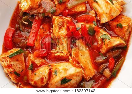 Plate with tasty chicken cacciatore, closeup