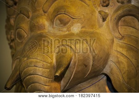 Spiritual Bronze statuette of a elephant face spiritual figure in a stall at a trade fair.