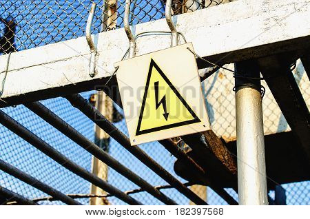 High voltage danger sign in fence of power plant