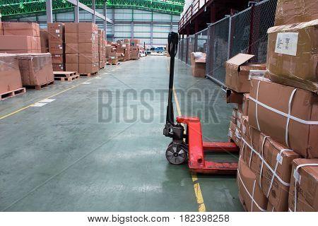 Hand lift and interior of warehouse. white, carton, handling